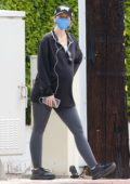 Katherine Schwarzenegger wears an oversized shirt and leggings while out for her morning walk in Brentwood, California