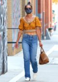 Katie Holmes wears an orange crop top as she steps out for shopping around Soho in New York City