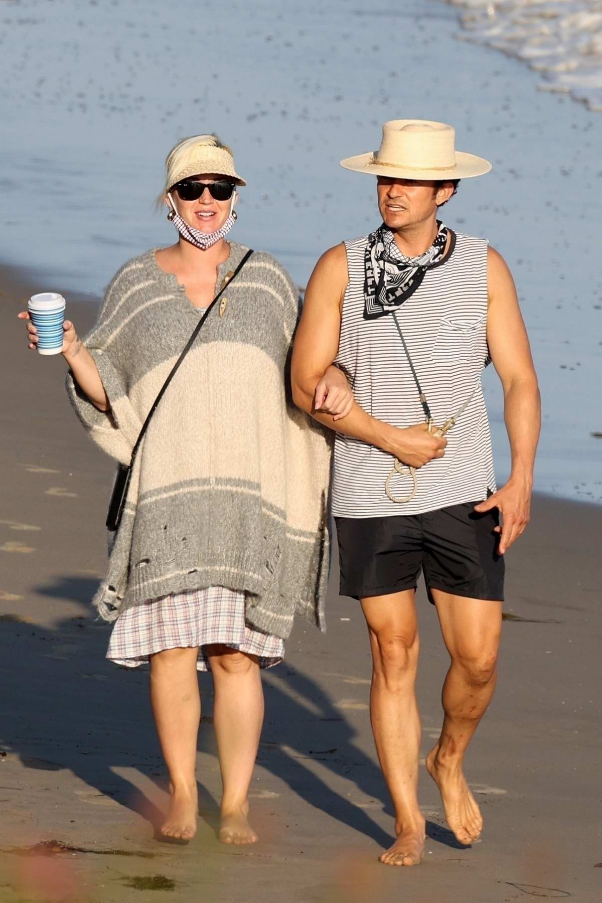 Katy Perry and Orlando Bloom enjoy a late-afternoon stroll on the beach in Santa Barbara, California