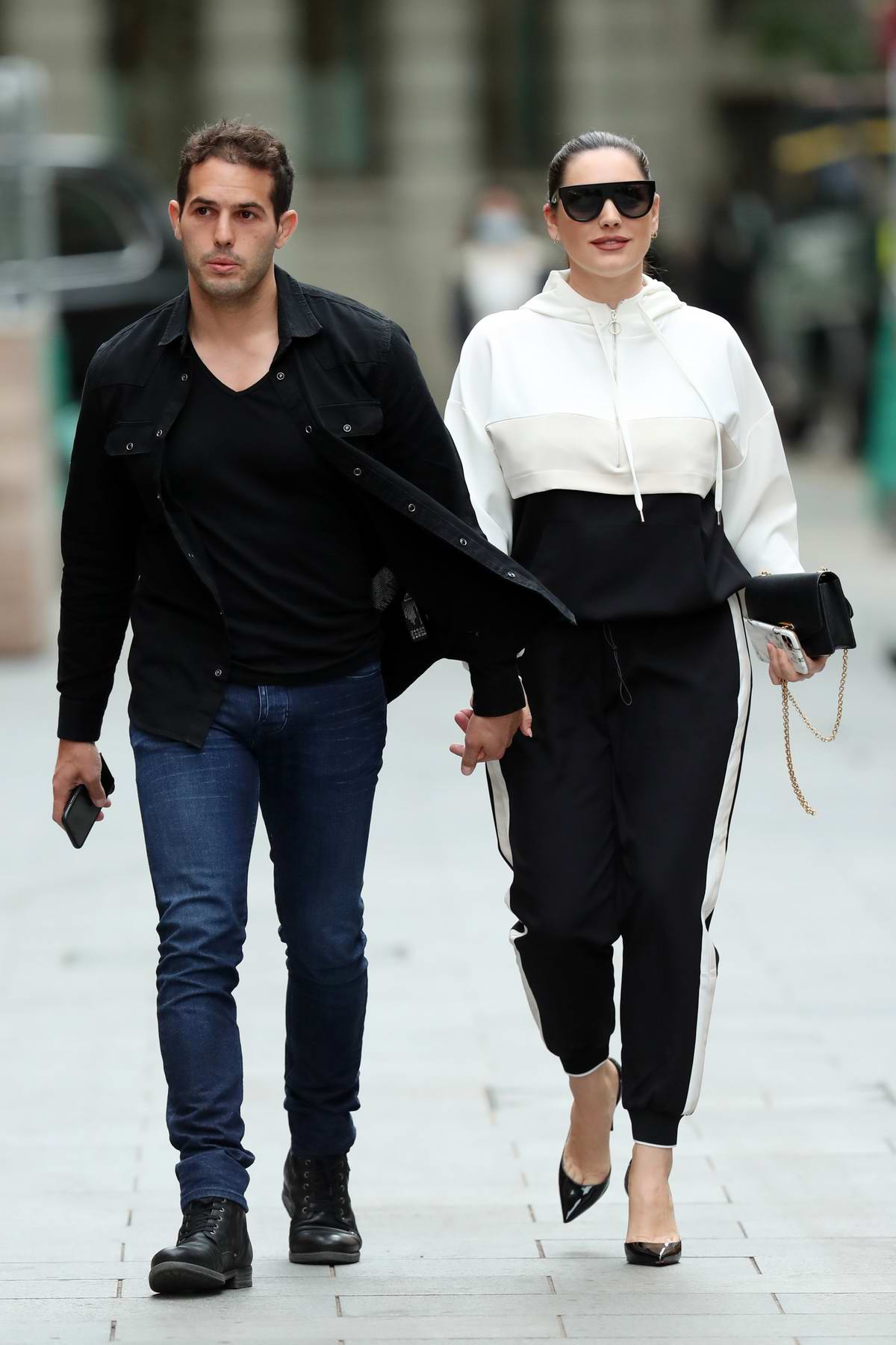 Kelly Brook and boyfriend Jeremy Parisi hold hands as they arrive at Heart Radio in London, UK