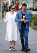Kelly Brook and Jeremy Parisi enjoy some ice cream while heading to the Global Radio studios in London, UK