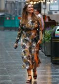 Kelly Brook is all smiles as she leaves Global Radio studios in a floral print dress in London, UK