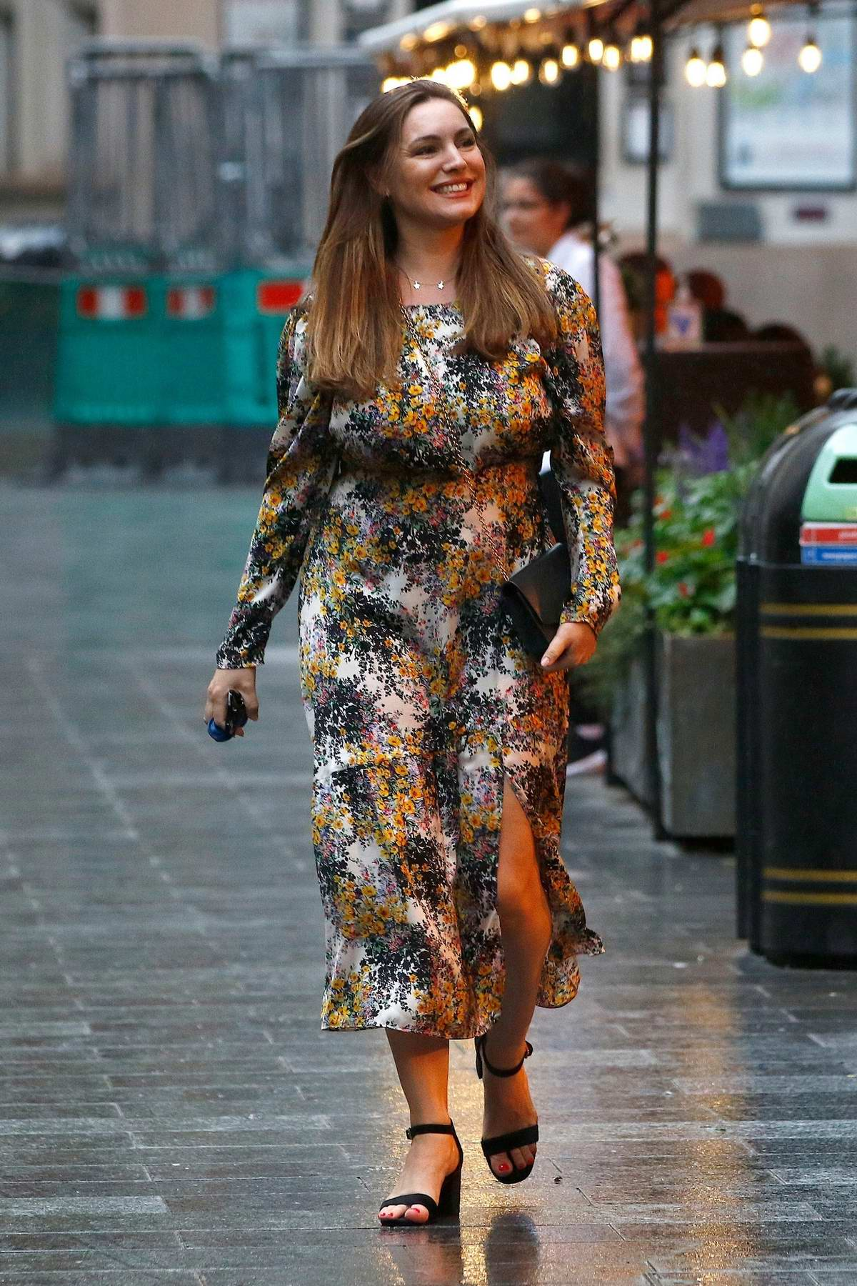 Kelly Brook is all smiles as she leaves Global Radio studios in a floral print dress in London, UK