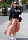 Kelly Brook is all smiles as she leaves Global Radio studios with Jeremy Parisi in London, UK