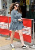 Kelly Brook looks cute in a gingham print mini dress as she arrives at the Global studios in London, UK