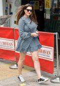 Kelly Brook looks cute in a gingham print mini dress as she arrives at the Global studios in London, UK