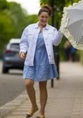 Kelly Brook looks stylish in a broderie dress and denim jacket as she strolls with Preeya Kalidas in London, UK