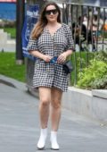 Kelly Brook looks stylish in a monochrome checkered mini dress as she leaves Global Radio studios in London, UK