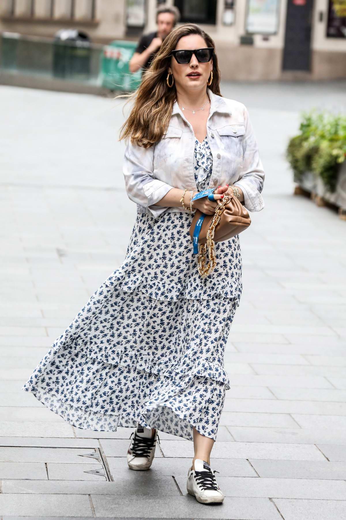 Kelly Brook seen wearing a summer dress as she leaves the Global Radio studios in London, UK