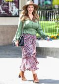 Kelly Brook wears a fedora with a green top and floral print skirt while arriving at the Global Radio studios in London, UK
