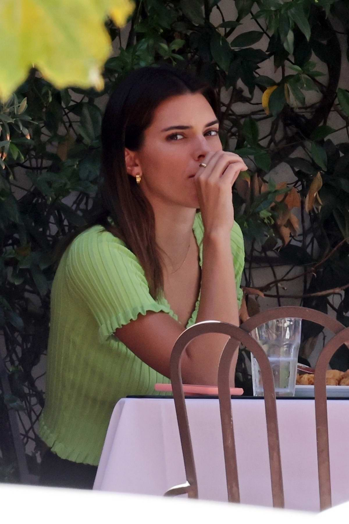 Kendall Jenner enjoys french fries & fish tacos with a friend at Taverna Tony in Malibu, California