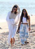 Kendall Jenner, Kourtney Kardashian, and Addison Rae hit the beach while taking a break from a photoshoot in Malibu, California