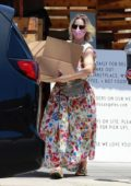 Kristen Bell wears floral print dress as she picks up some food for the 4th of July celebrations in Los Feliz, California