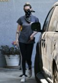 Kristen Stewart sports a grey top and Adidas leggings as she leaves an office building in Los Angeles