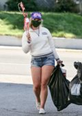 Lana Del Rey flaunts her legs as she picks up supplies for the 4th of July decorations in Los Angeles