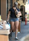 Lana Del Rey flaunts her legs in tiny denim shorts as she stops by 7-Eleven in Los Angeles