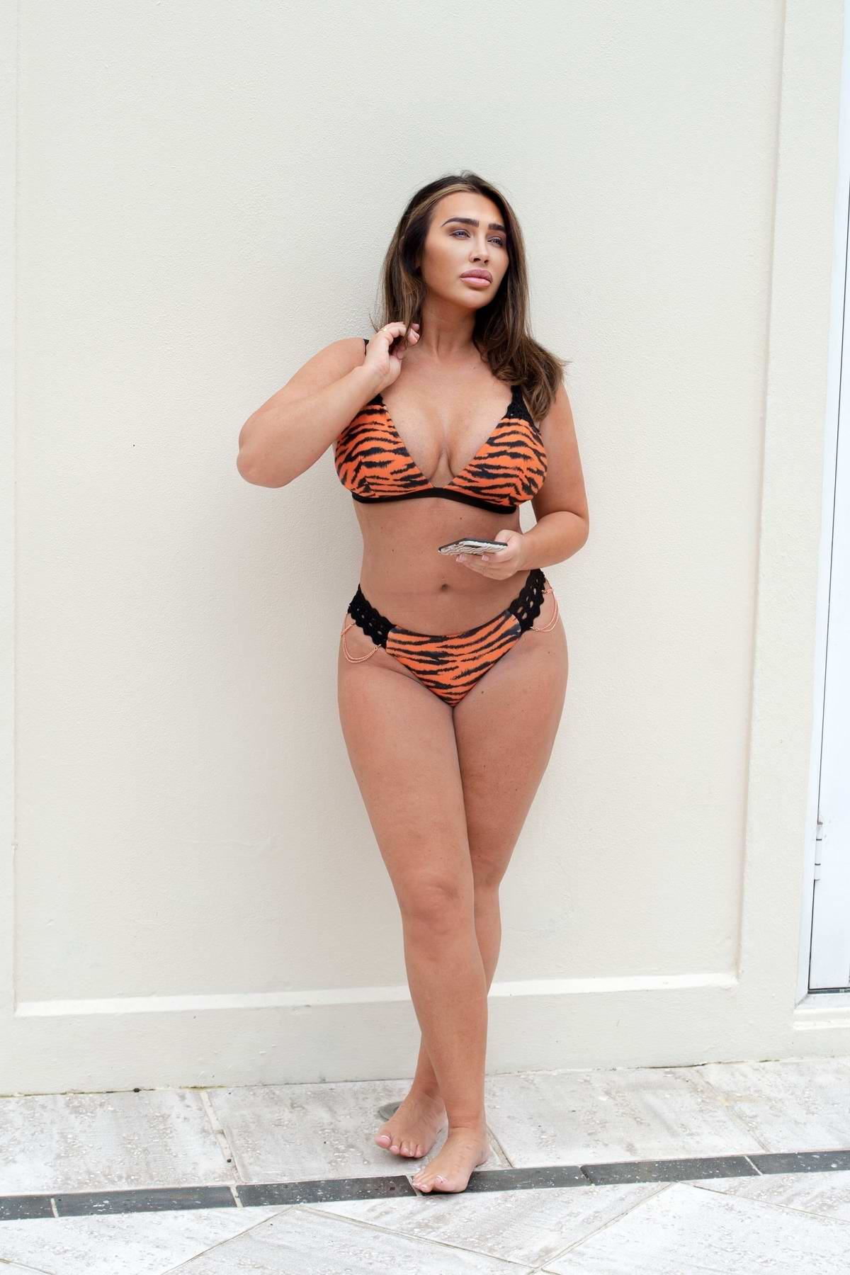 Lauren Goodger poses in an animal print bikini during a photoshoot in London, UK