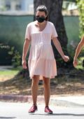 Lea Michele cradles her baby bump on a walk with her husband and her mom in Santa Monica, California