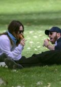 Lily James and Chris Evans enjoy some ice cream while on a date at a park in London, UK