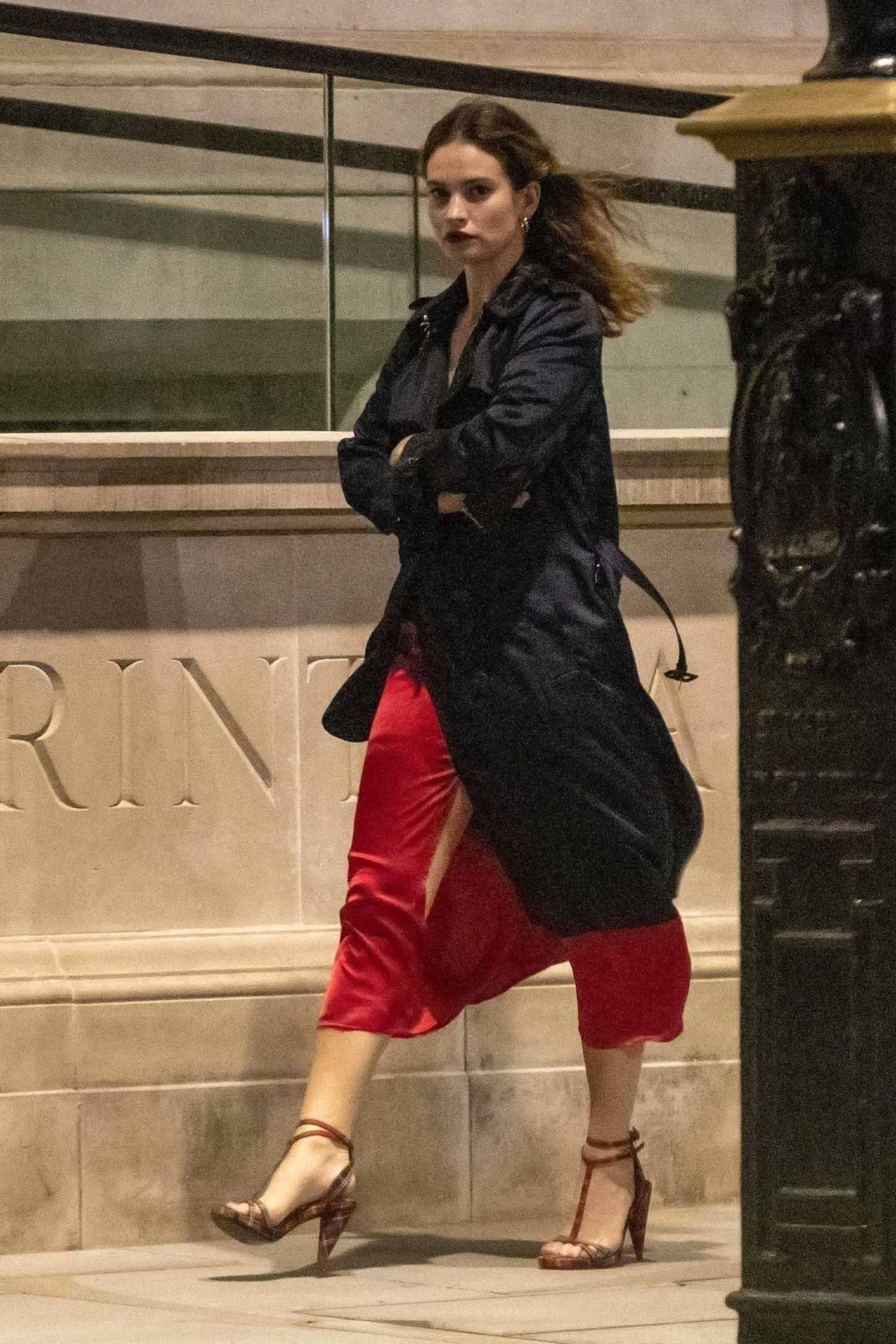 Lily James stuns in a red dress during a night out at Mark's Club in London, UK