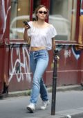 Lily-Rose Depp wears a white crop top and jeans as she steps out in Paris, France