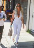 Lindsey Pelas wears a plunging jumpsuit during a lunch outing at Sugar Taco restaurant in West Hollywood, California