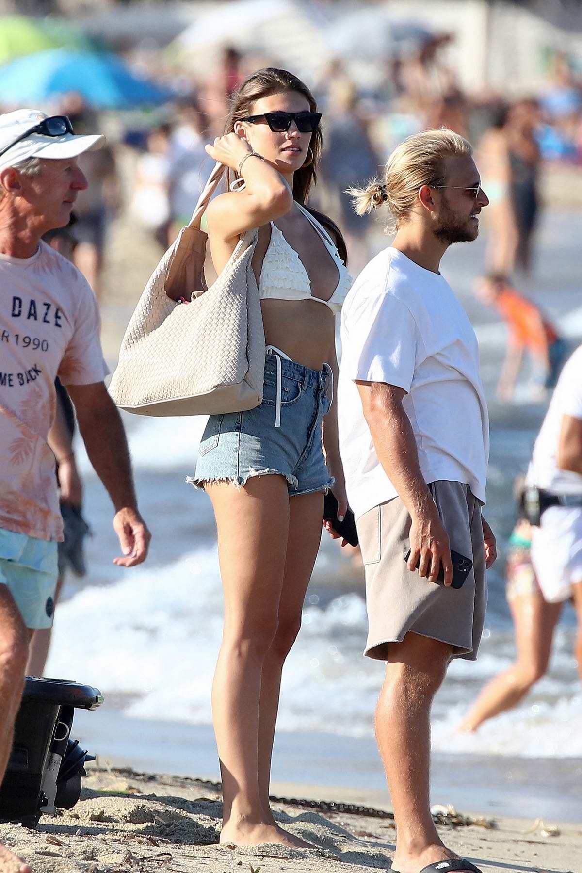 Lorena Rae hits the beach wearing a white bikini top and denim shorts in Saint-Tropez, France