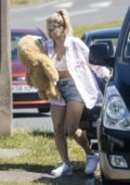 Lottie Moss carries her teddy bear as she arrives at her mum's residence in Sussex, UK