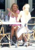 Lottie Moss looks pretty in a strawberry print pink mini dress while enjoying lunch with a friend in London, UK