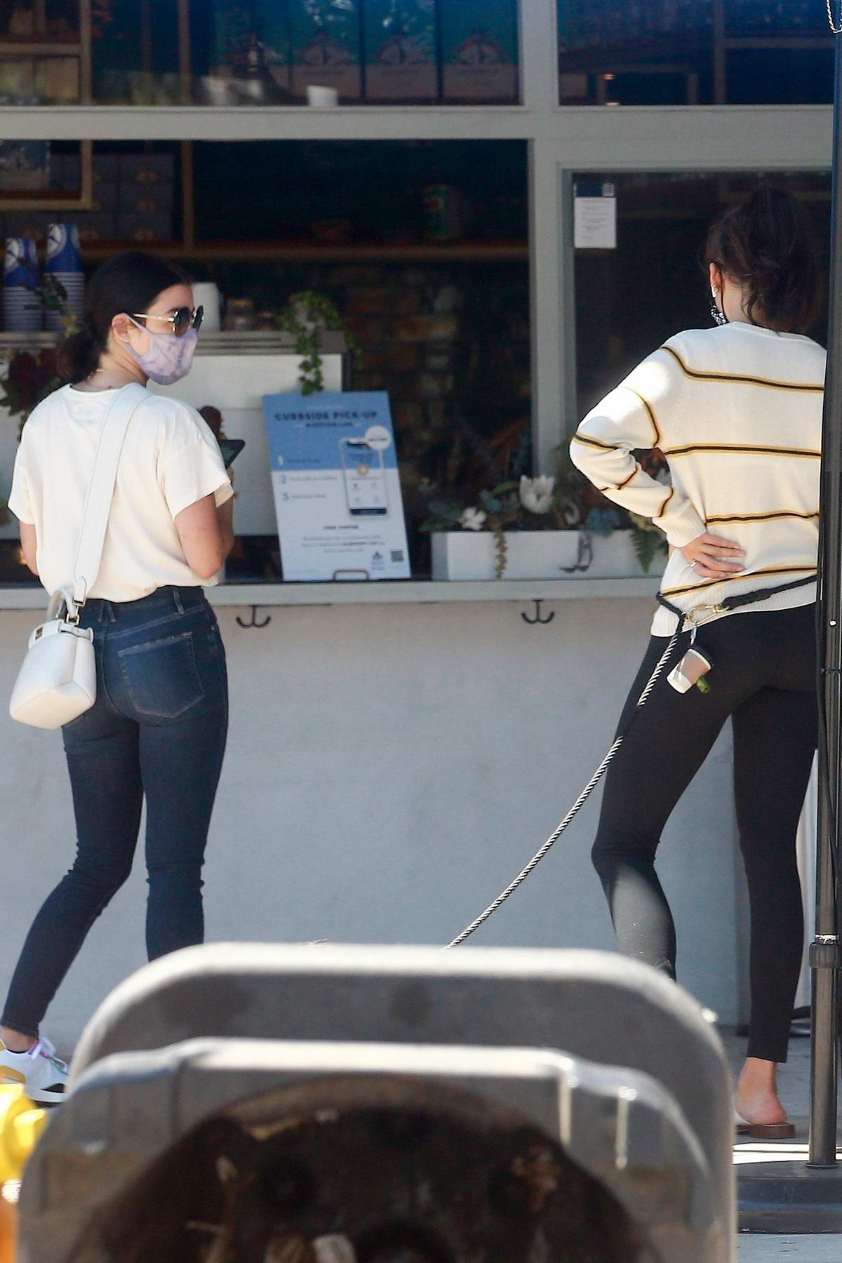 Lucy Hale and Nina Dobrev bump into each other at a coffee shop while they run errands in Los Angeles