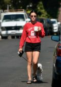 Lucy Hale wears a NYU sweatshirt and black shorts as she enjoys her morning coffee while walking her dog in Studio City, California