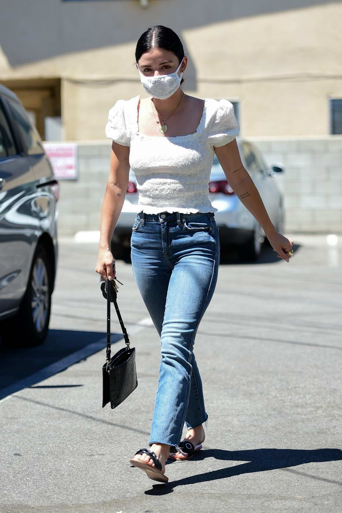 Lucy Hale looks great in white top and jeans while visiting a skin care and waxing studio in Los Angeles