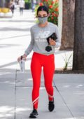 Lucy Hale sports bright red leggings as she gets in her workout at Training Mate in Studio City, California