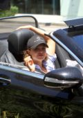 Mara Teigen enjoys the warm weather with a mystery man in Hollywood, California