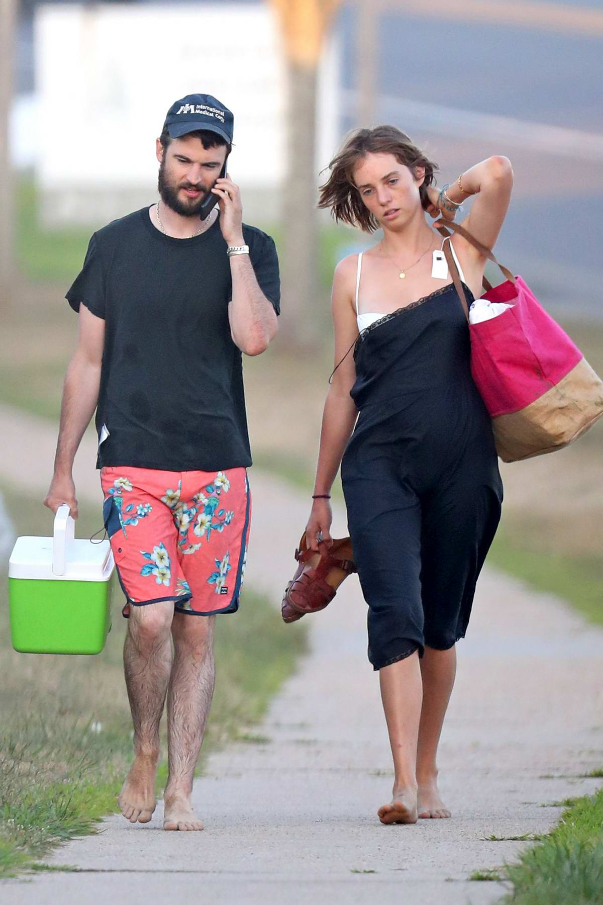 Maya Hawke and Tom Sturridge seen walking back after a day at the beach in The Hamptons, New York