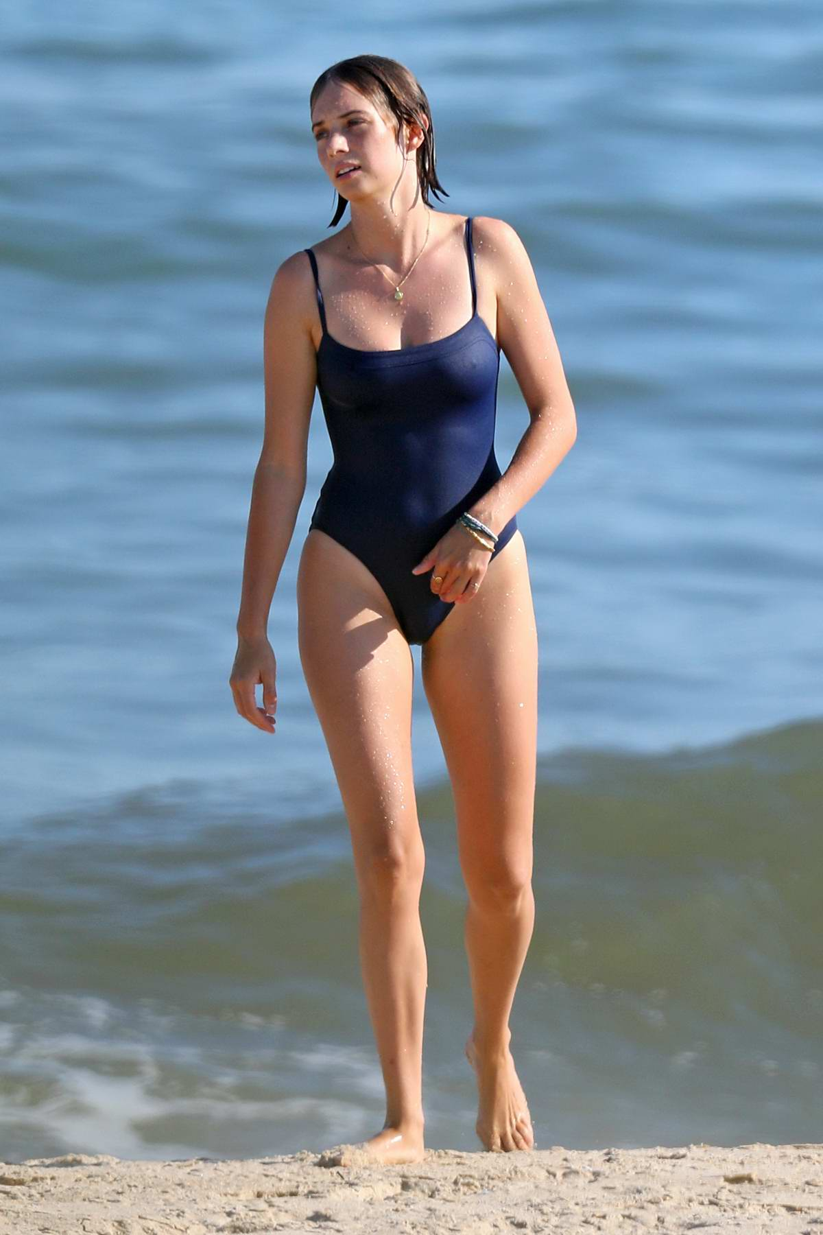 Maya Hawke sports a navy swimsuit as she hits the beach for a swim and some exercise in The Hamptons, New York