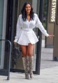 Maya Jama looks stylish in a white shirt dress and snakeskin boots as she leaves Riverside Studios in London, UK