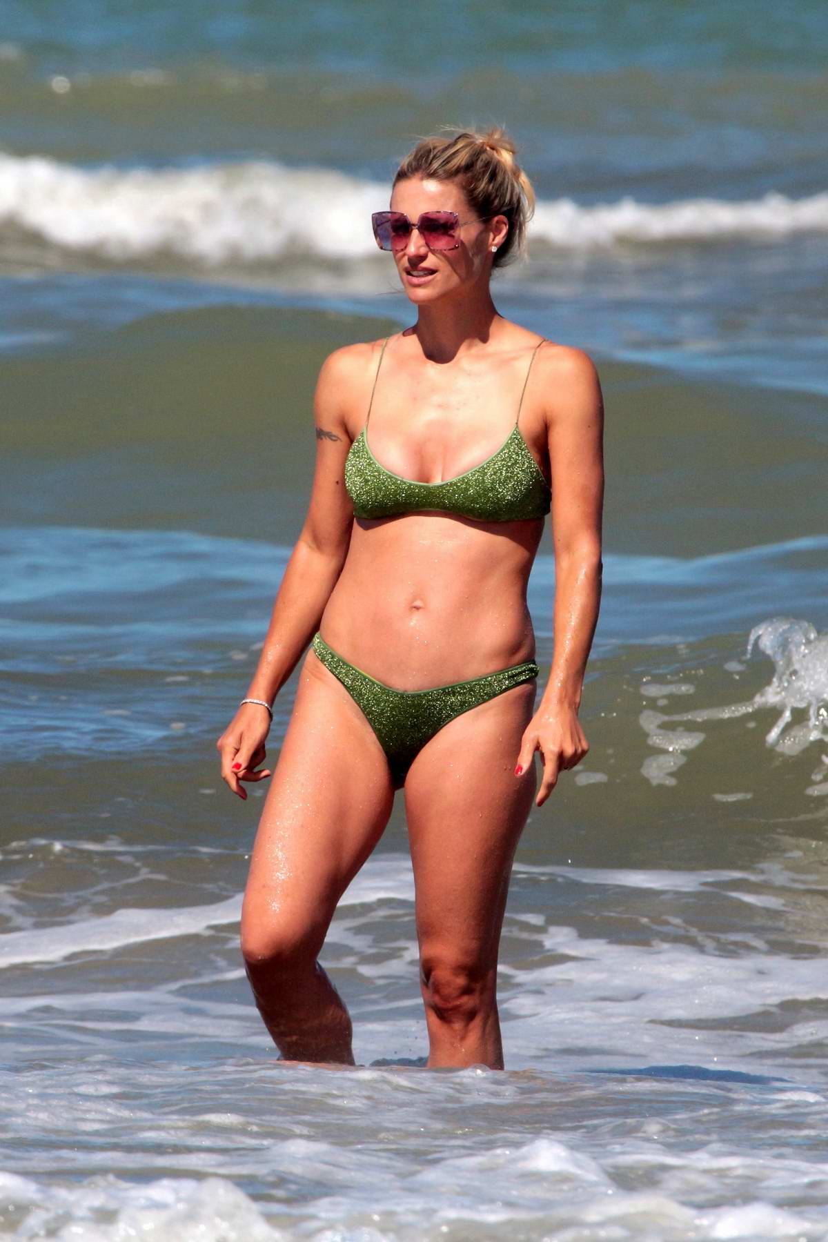 Michelle Hunziker spotted in a green bikini while on vacation with Tomaso Trussardi in Milano Marittima, Italy