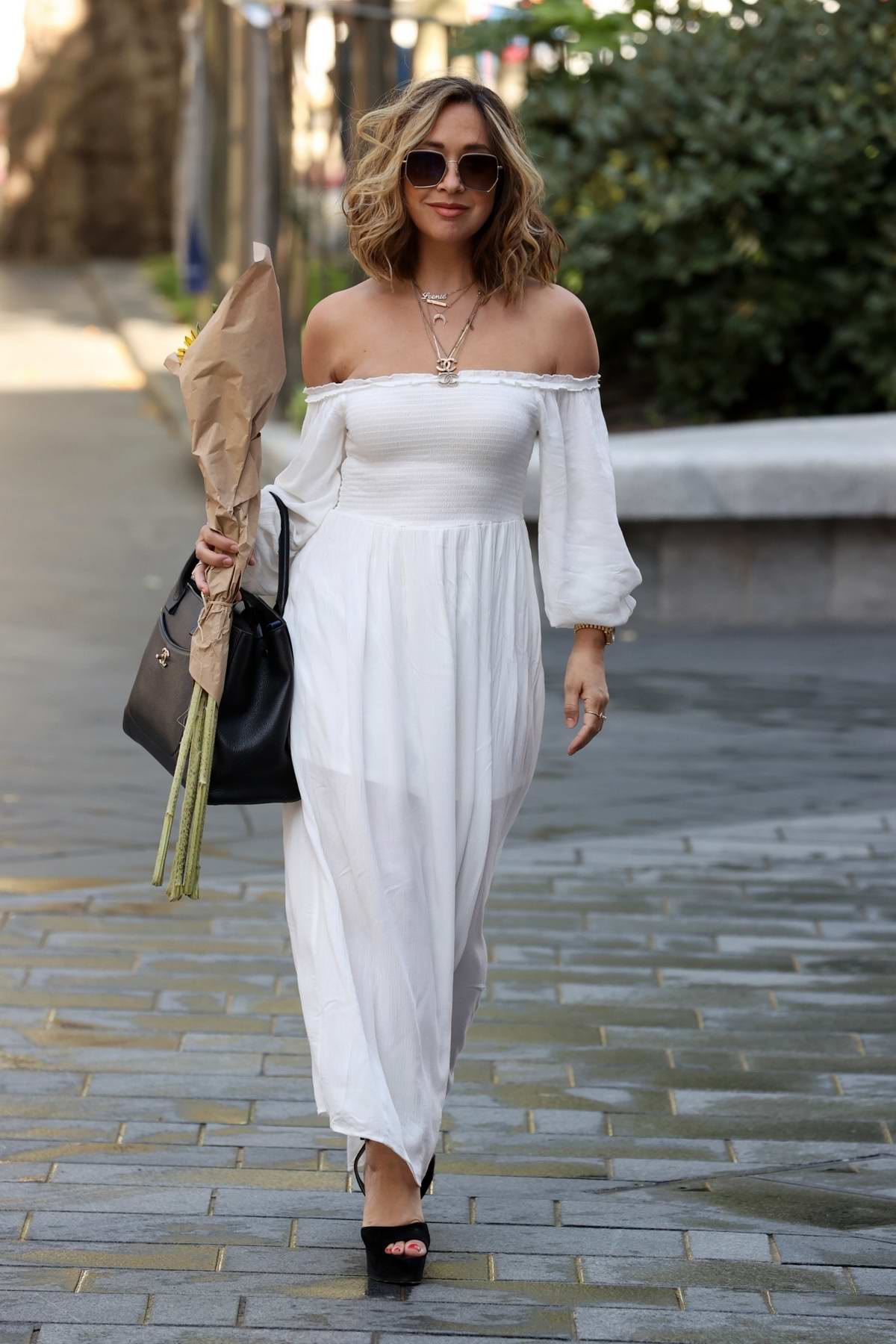 Myleene Klass looks chic in white as she arrives at the Smooth Radio Studios in London, UK