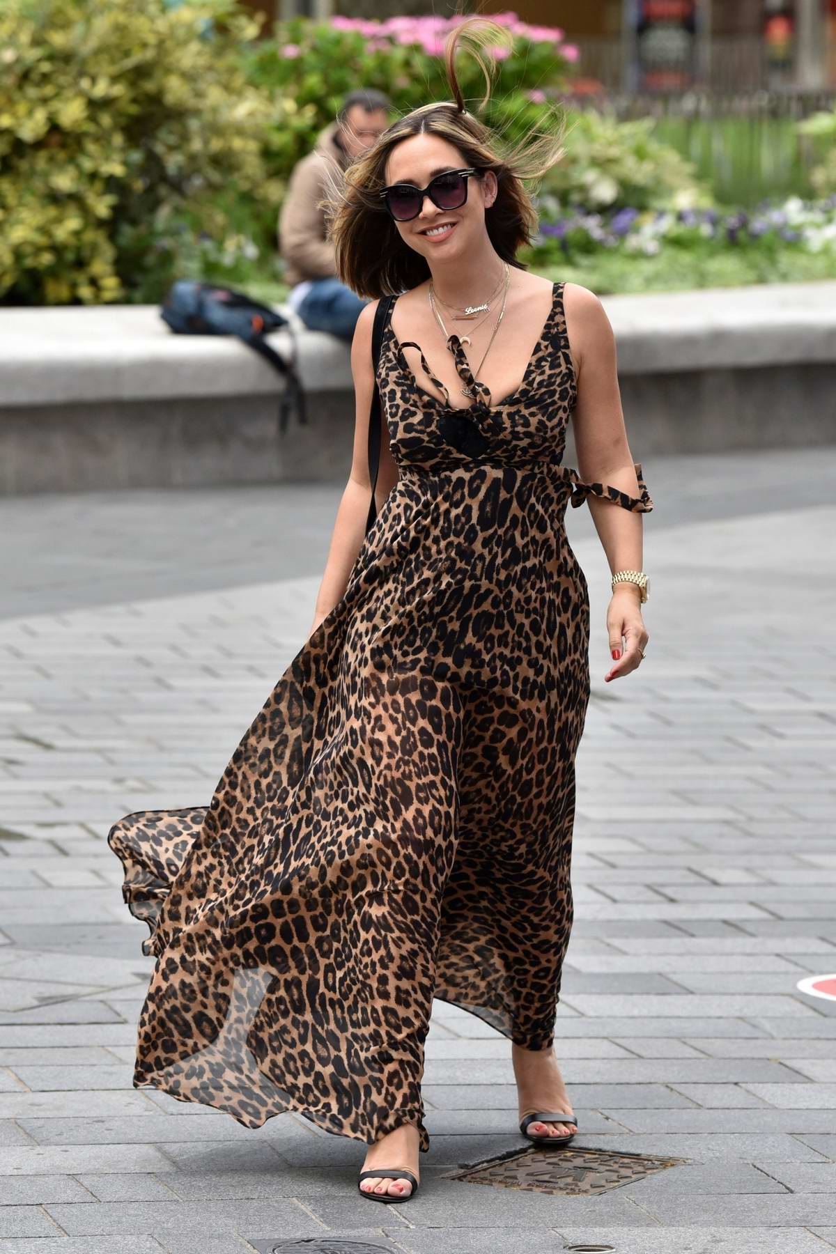 Myleene Klass shows off her new blonde hair with plunging leopard print dress as she arrives at Smooth Radio in London, UK