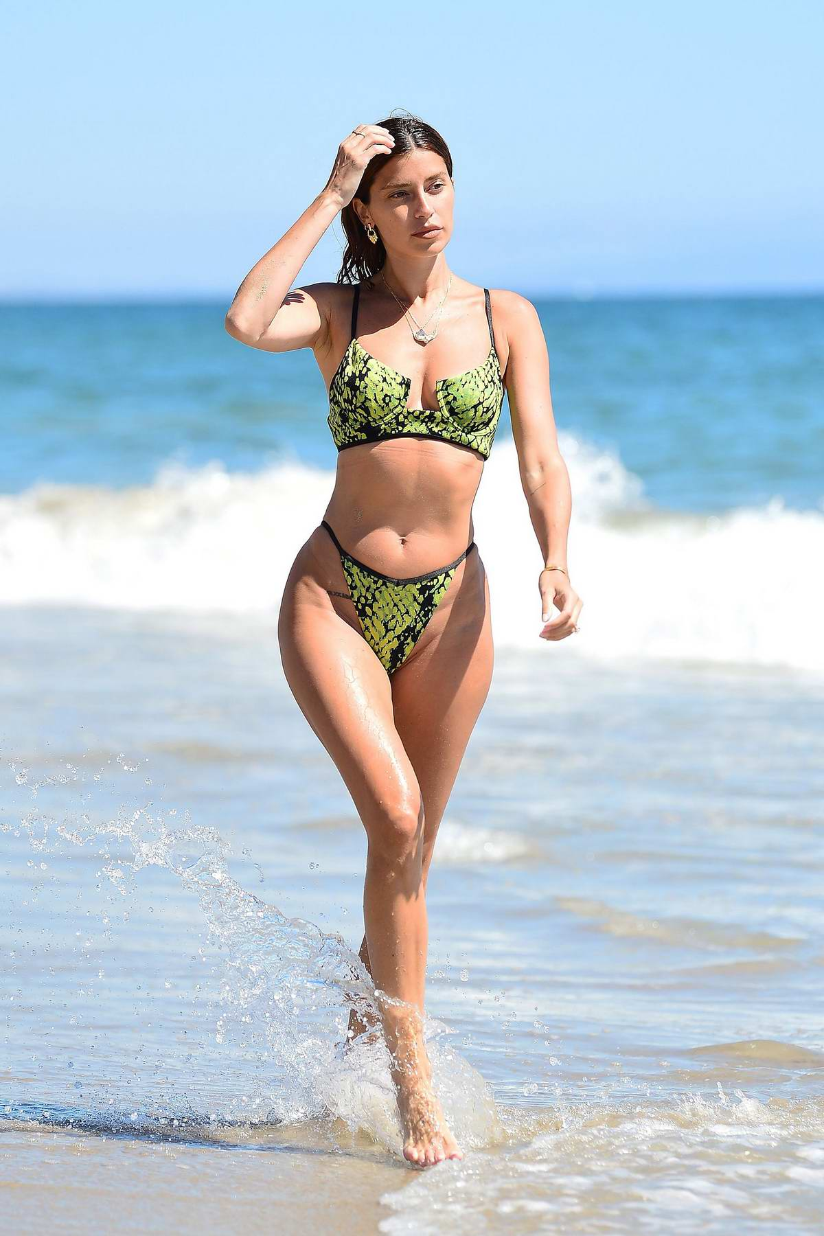 Nicole Williams puts on a green bikini for a beach day in Malibu, California