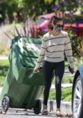 Nina Dobrev seen outside her home taking garbage bins inside before heading out on her Tesla, West Hollywood, California