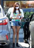 Nina Dobrev shows off her toned legs in denim shorts during a trip to Erewhon Market with a friend in Venice, California