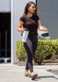 Olivia Munn looks fit in black tee and leggings as she leaves the gym in Los Angeles