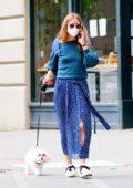 Olivia Palermo looks stylish in a blue semi-sheer skirt as she walks her dog Mr Butler in Brooklyn, New York City