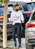 Olivia Wilde dons white sweatshirt and black leggings while out running errands in Los Angeles