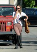 Olivia Wilde is all smiles as she enjoys some horseback riding in Thousand Oaks, California