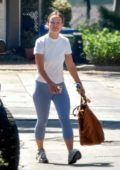 Olivia Wilde wears a casual white tee and blue leggings while running a few errands in Silver Lake, California