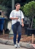Olivia Wilde wears a white t-shirt with black and blue leggings while out in Los Angeles
