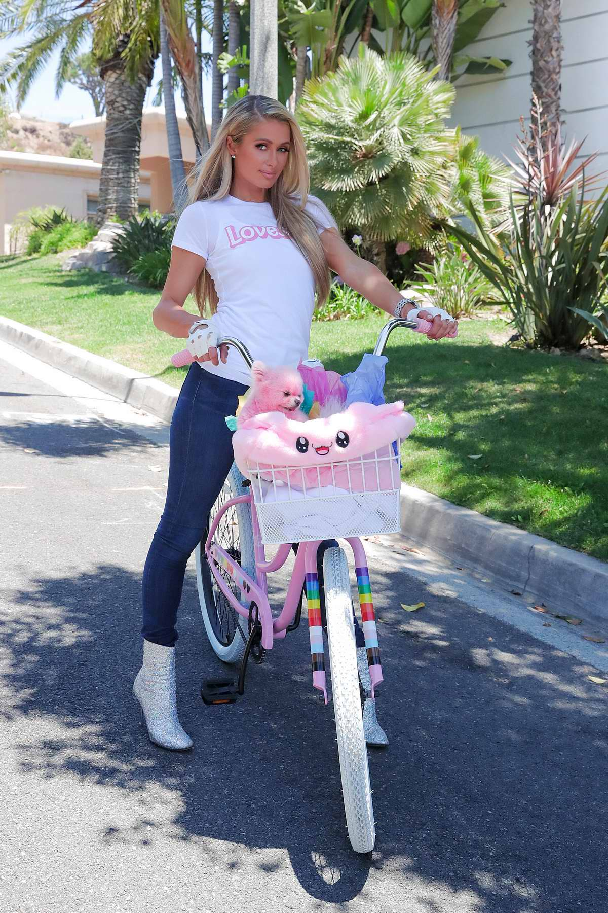 Paris Hilton enjoys a bike ride with her adorable pooch in Beverly Hills, California